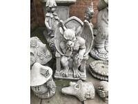 Stone garden gargoyle statue