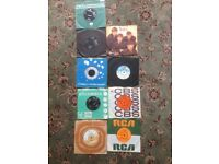 a selection of singles bowie/dylan/beatles