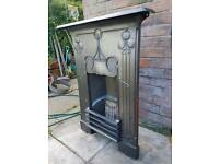 Original cast iron art nouveau bedroom fireplace.