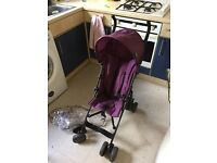 Red kite pushchair with rain cover