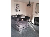 Black and silver crushed velvet corner sofa and footstool
