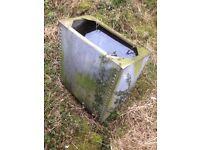 Vintage riveted galvanised tank