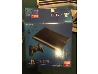 PS3 500GB super slim in box with 22 games