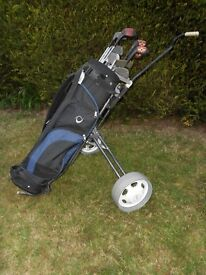 Golf clubs, bag, trolley and lots of golf balls