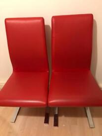 Quick sale !! A pair of Red leather dining chairs