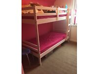 Set of bunk beds and a pink toddler bed.