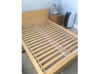 Ikea Wooden double bed and bedside tables. One bed side cabinet is slightly darker wood