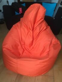 Trendy orange bean bag - with head support - very comfortable and like new!