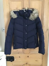 Ladies puffer jacket with fur-trimmed hood.