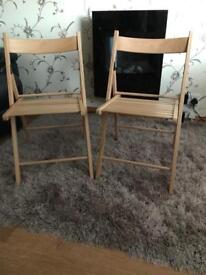 Pair of solid wood folding chairs. Unused