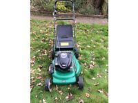 Qualcast Selfpropelled 22inch petrol lawnmower with side discharge.