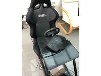 Rage Racer gaming chair + steering wheel and pedals.