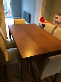 Mango effect dining table with 6 faux leather cream matching chairs