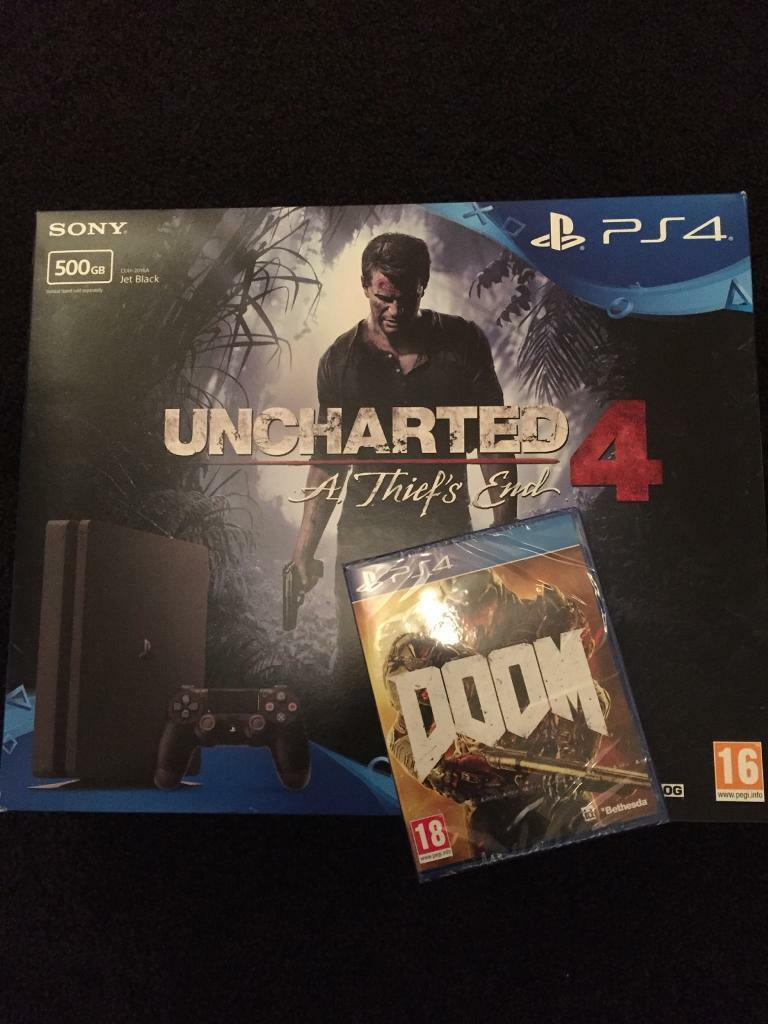 PS4 SLIM WITH 4 GAMES INC UNCHARTED & DOOM