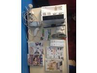 Nintendo Wii, All working cables, 2 controllers, nunchuck, 5 games with Charger stand& battery packs