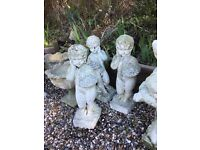 A pair of garden stone cherubs vintage. A boy and a girl. 30ins high