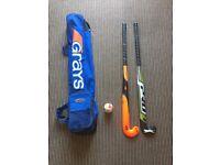 Hockey sticks and bag and ball