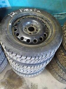 FORD FIESTA MAZDA 2 MAZDA2 WINTER SNOW TIRES AND RIMS ** STUDDED *** 185/60R/15 GOODYEAR NORDIC WINTER FOR OEM WHEELS