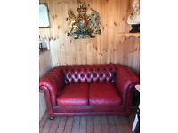Oxblood red Chesterfield two-seater leather sofa