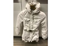 Girls designer coat, Marithe Francois Girbaud, cram colour skirting, cream winter coat with good.