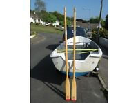 "New old stock a matching pair of 7 foot 4"" wooden Lahna boat oars"