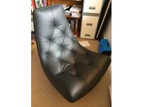 Very good condition black leather swivel chair on metal leg