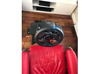 Logitech wheel, pedals and adjustable stand.
