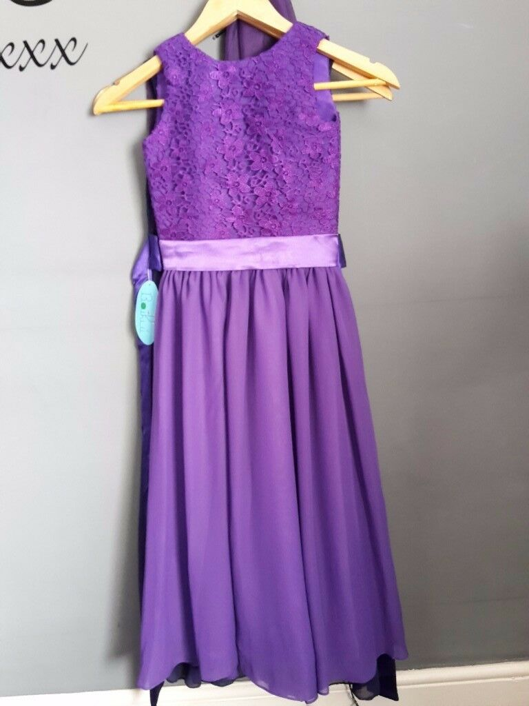 Age 9-10 cadburys purple bridesmaid dress | in Manchester | Gumtree