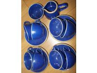 Eight Cups and Saucers. One Sugar Bowl. One Milk Jug. Navy Blue.
