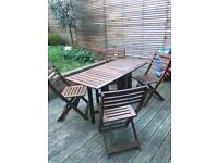 Brown wooden Table + 4 folding chairs