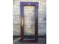 Outward opening door frame with panel.