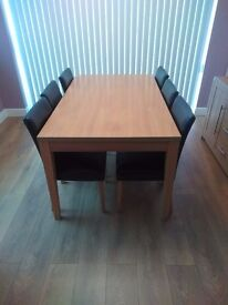 Oak effect table and 6 dark brown faux leather chairs