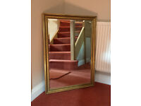 Gilt finished rectangular mirror. Bevilled glass. Excellent condition. Heavy quality.