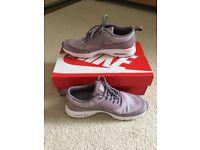 Lilac Nike trainers