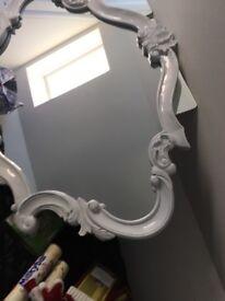beautiful ornate white mirror