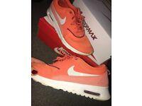 Nike orange theas, size 5