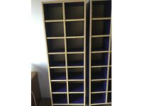 Ikea storage/display pigeon hole units. Blue with light wood surround.