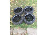 "Set of 17"" black alloys with really good tread"