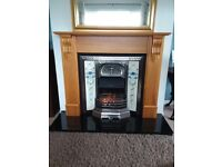 Fireplace with cast iron insert and granite hearth