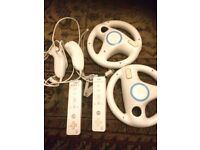 Nintendo wii with 20 games, two controlers and nunchucks, two wheels and all cables needed.