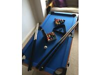 BCE pool table with lots of accessories. As new condition. Folds for storing. 138cmLx70cmWx77cmH