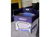 Graco playpen, foldable into its own travel bag complete with sun canopy. Two playmats too