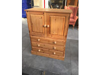 Pine Storage unit , Good quality and condition. Has 3 drawers at the base and double cupboard .
