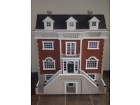 Four storey dolls house with lots of accessories.