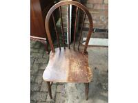 Genuine Ercol windsor fan back chair with early saddle seat