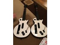 2x Wii Guitars and 2 games