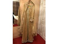 Indian party outfit size large. Gold glittery dress with lehenga skirt