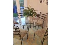 Glass round table and chairs