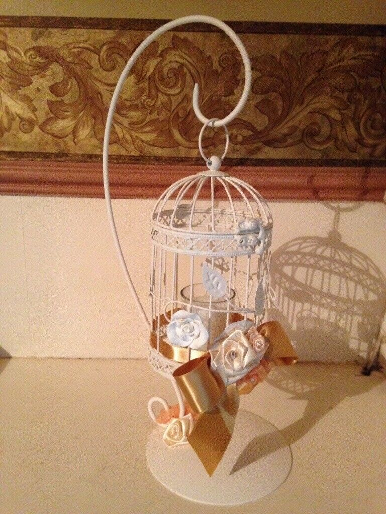 Caged design candle holder with decorative flowers and ribbon