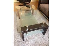 Glass and dark wood coffee table
